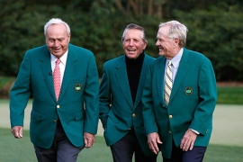 Masters champions from left, Gary Player, Jack Nicklaus, and Arnold Palmer tour Amen Corner at Augusta National Golf Club on Tuesday April 8, 2014.