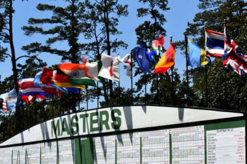 Wind gusts past flags of participating countries over a scoreboard during Round 3 of the 80th Masters Golf Tournament at the Augusta National Golf Club on April 9, 2016, in Augusta, Georgia. / AFP / DON EMMERT (Photo credit should read DON EMMERT/AFP/Getty Images)