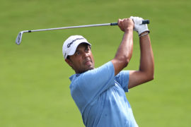 GREENSBORO, NC - AUGUST 21: Arjun Atwal hits his second shot on the 14th hole during the third round of the Wyndham Championship at Sedgefield Country Club on August 21, 2010 in Greensboro, North Carolina. (Photo by Hunter Martin/Getty Images)
