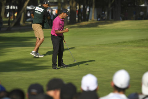 Shubhankar Sharma celebrates a par save on 18 with caddie Gurbaaz Mann in back ground. Image credit PGA TOUR.jpg